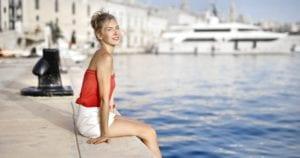 woman sitting near swimming pool 1456268 scaled e1575565494551